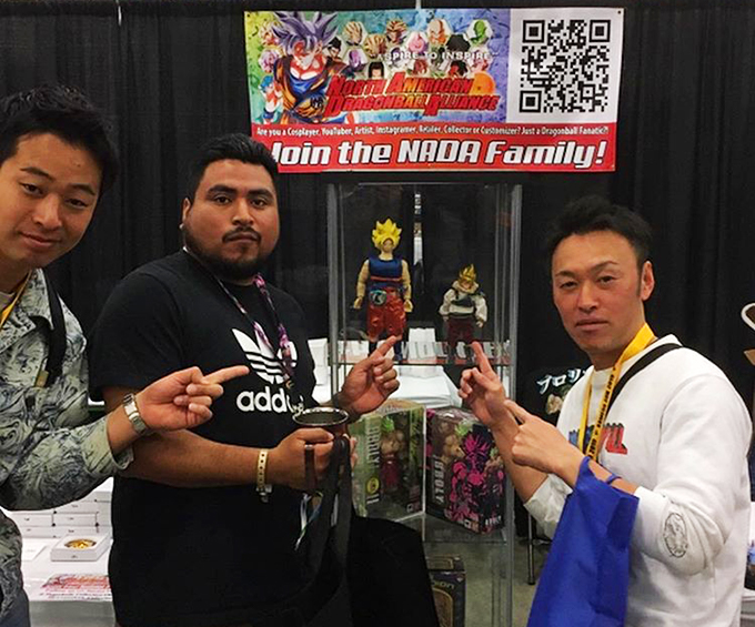 Hitoshi Uchida stands next to his goku yardrat figure